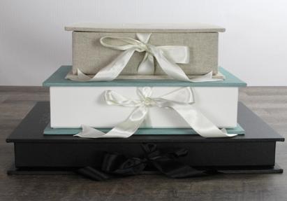 Seldex Portfolio Boxes. Top: Natural Blend Linen with Bridal White Ribbon. Center: Cool Mint Asahi with White Ribbon. Bottom: Black Buckram with Black Ribbon.